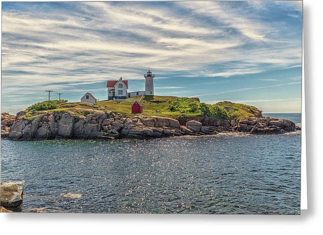 Warm Clouds Over Nubble Lighthouse Greeting Card by Brian MacLean