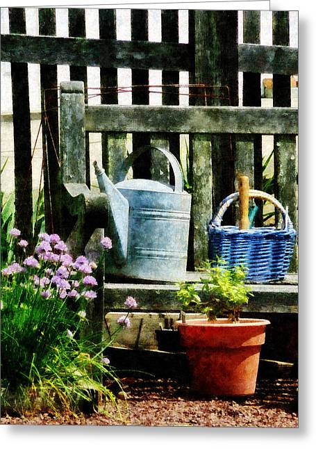 Watering Can And Blue Basket Greeting Card by Susan Savad