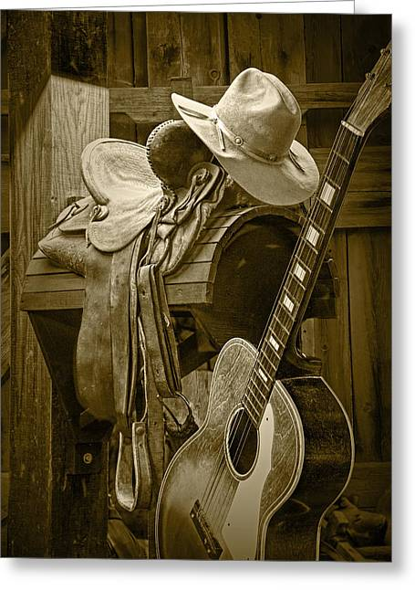 Western Photographs Greeting Cards - Western Country 6 String Acoustic Guitar in Sepia Tone with Horse Saddle Greeting Card by Randall Nyhof