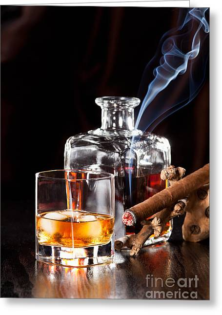 Alcohol Greeting Cards - Whisky in glass with ice cubes and a smoking cigar Greeting Card by Wolfgang Steiner