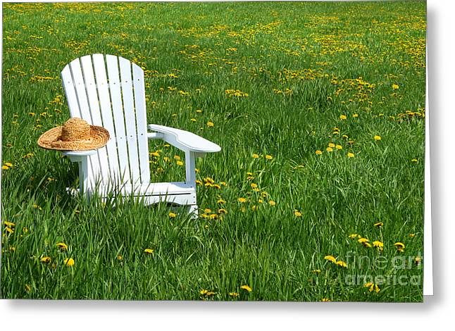 Adirondack Greeting Cards - White chair with straw hat Greeting Card by Sandra Cunningham