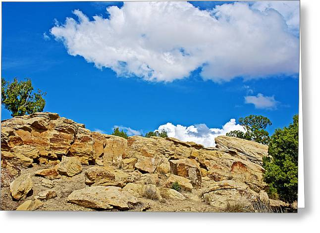 Rocks Greeting Cards - White Clouds and Blue Sky Above Rocks north of I 70 in Eastern Utah  Greeting Card by Ruth Hager