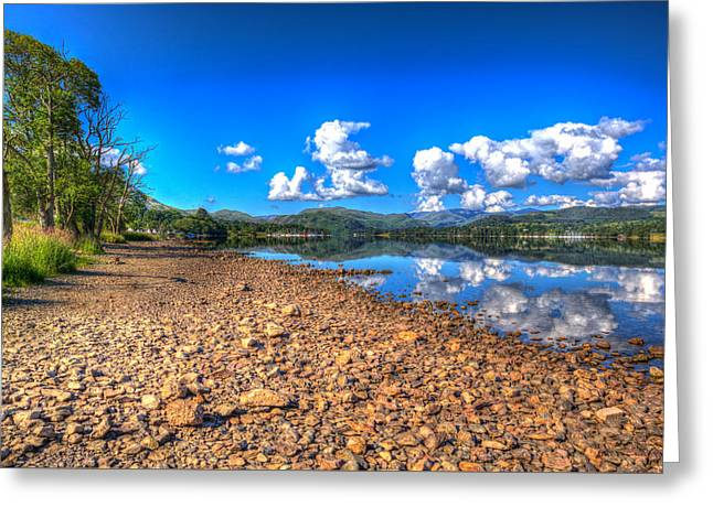 Glass Reflecting Greeting Cards - White fluffy clouds reflections on beautiful lake with mountains and water like glass on calm day Greeting Card by Michael Charles