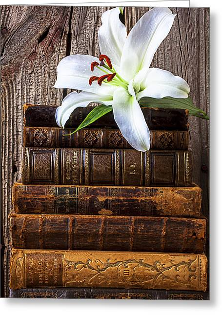 Literary Greeting Cards - White lily on antique books Greeting Card by Garry Gay