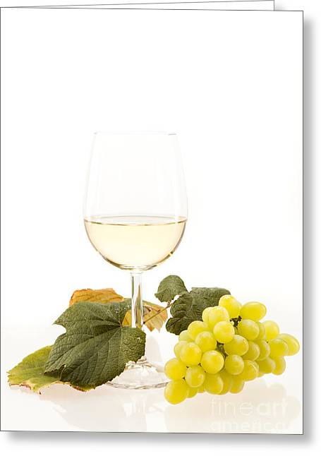 Beverage Greeting Cards - White wine in glass with grapes Greeting Card by Wolfgang Steiner