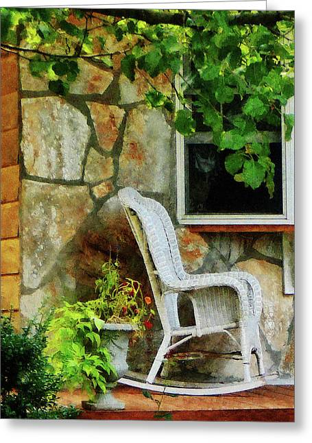 Wicker Rocking Chair On Porch Greeting Card by Susan Savad