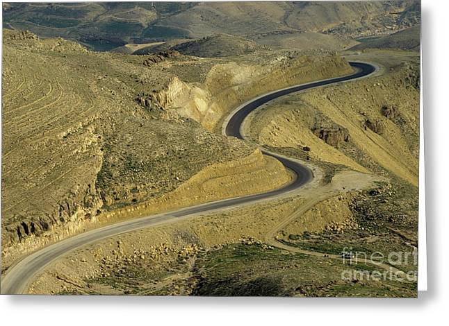 Jordan Hill Greeting Cards - Winding  King road in Wadi Mujib Valley Greeting Card by Sami Sarkis