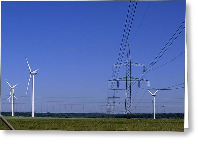 Windmills And High Voltage Transmission Greeting Card by Norbert Rosing