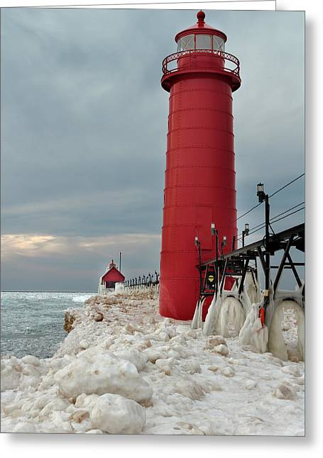 The Houses Greeting Cards - Winter at Grand Haven Lighthouse Greeting Card by Susan Rissi Tregoning