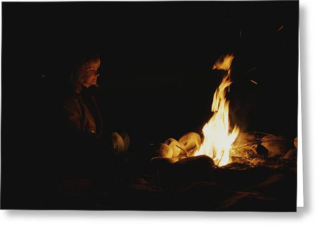 Mid Adult Women Photographs Greeting Cards - Woman At A Campfire At Night Greeting Card by Todd Gipstein