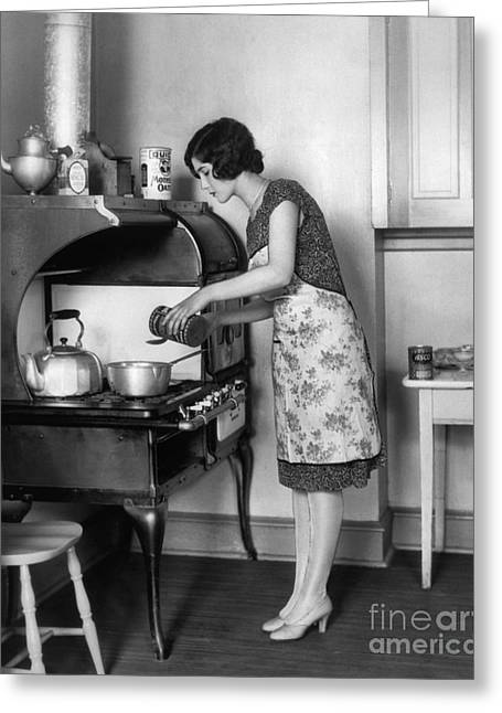 1930s Candid Greeting Cards - Woman At Stove Cooking, C.1920s Greeting Card by H. Armstrong Roberts/ClassicStock