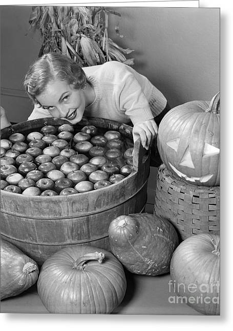 Woman Bobbing For Apples, C.1950s Greeting Card by H. Armstrong Roberts/ClassicStock