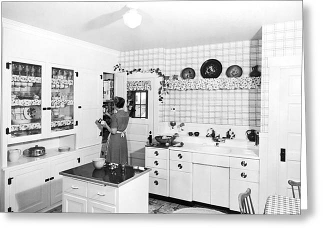 Home Appliance Greeting Cards - Woman Cooking In Her Kitchen Greeting Card by Underwood Archives
