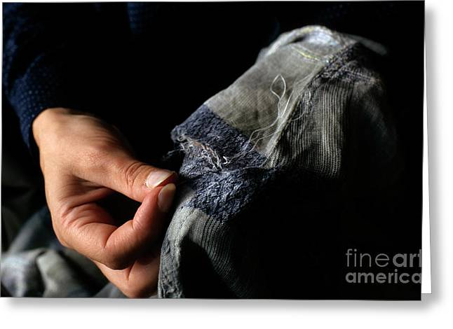 Woman Fixing A Hole With A Needle And Thread Greeting Card by Sami Sarkis