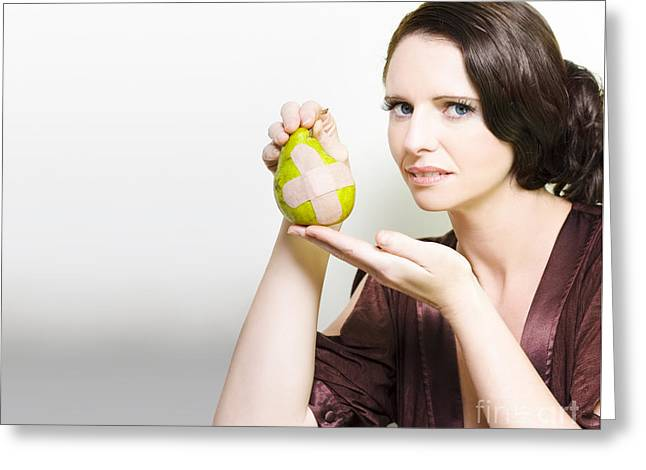 Bandaid Greeting Cards - Woman Holding Bruised Fruit Greeting Card by Ryan Jorgensen