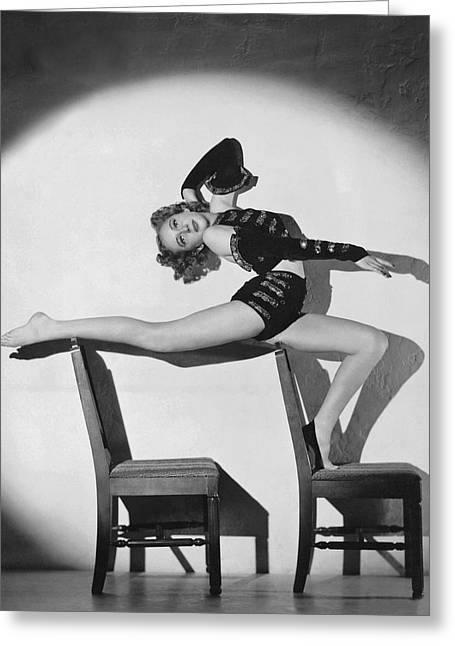 Woman In Acrobatic Dance Pose Greeting Card by Underwood Archives