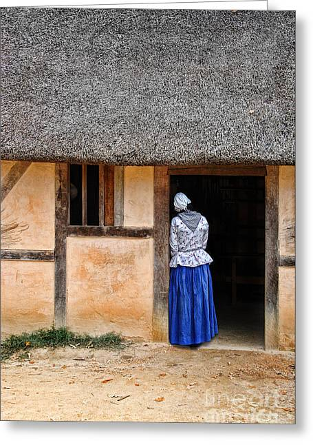 Thatch Greeting Cards - Woman in Doorway of a Thatched Roof Cottage Greeting Card by Jill Battaglia