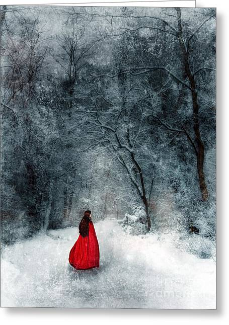 Period Clothing Greeting Cards - Woman in Red Cape Walking in Snowy Woods Greeting Card by Jill Battaglia