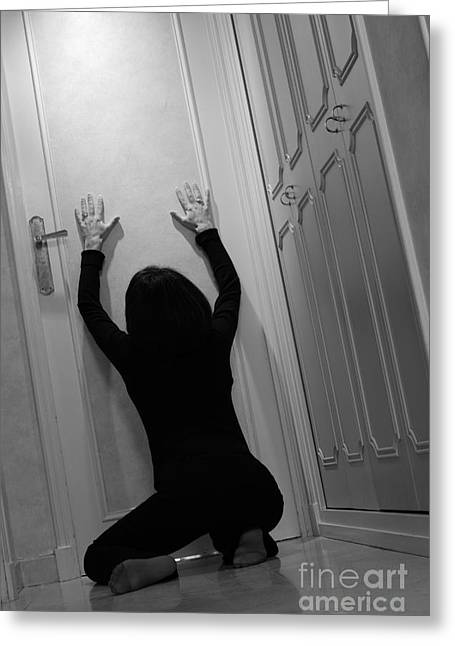 Forgiveness Greeting Cards - Woman kneeling in corridor with hands on closed door Greeting Card by Sami Sarkis