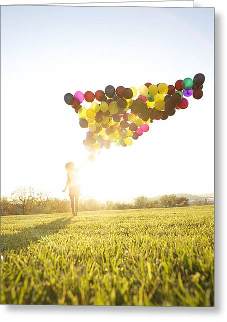 Sun Flare Greeting Cards - Woman Outside With Balloons Greeting Card by Gillham Studios