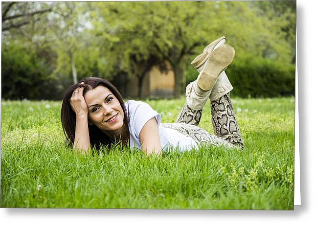 Laying On Stomach Greeting Cards - Woman relaxing on the grass in springtime Greeting Card by Newnow Photography By Vera Cepic