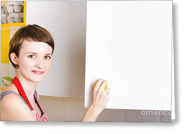 Woman Searching Kitchen Cupboard For Ingredients Greeting Card by Jorgo Photography - Wall Art Gallery