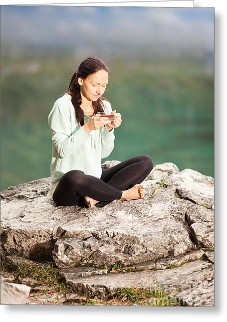 Lifestyle Greeting Cards - Woman sitting on a rock and drinking tea Greeting Card by Wolfgang Steiner