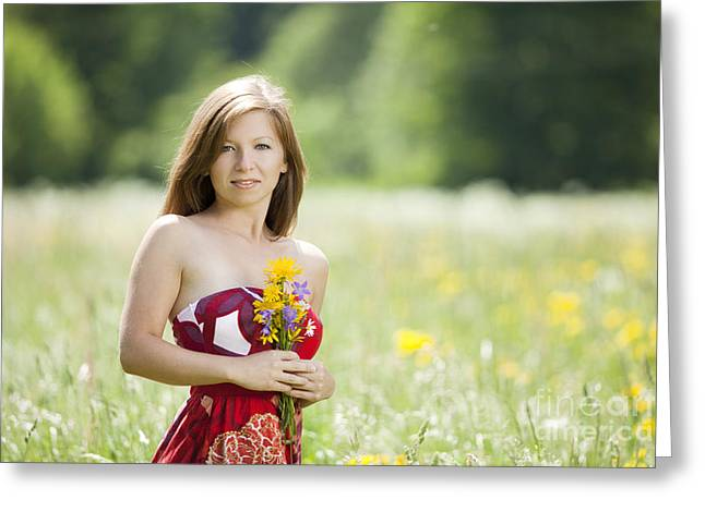 Joy Greeting Cards - Woman with flowers in a meadow Greeting Card by Wolfgang Steiner