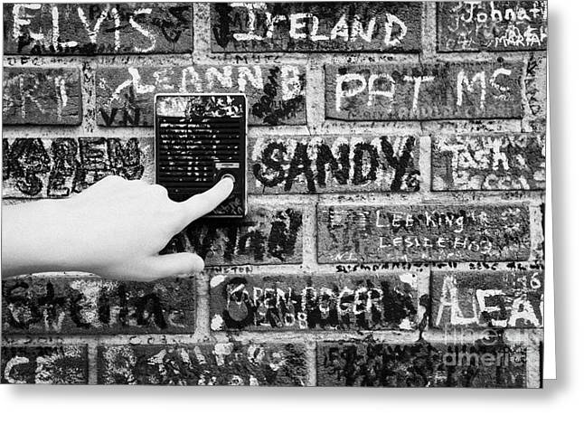 American Grafitti Greeting Cards - Womans Hand Pushing Old Intercom Button On Wall Covered In Graffiti Outside Graceland Memphis Greeting Card by Joe Fox