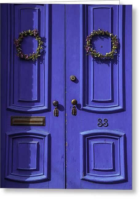 Wreath On Blue Doors Greeting Card by Garry Gay