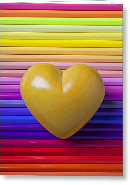 Concept Photographs Greeting Cards - Yellow heart on row of colored pencils Greeting Card by Garry Gay