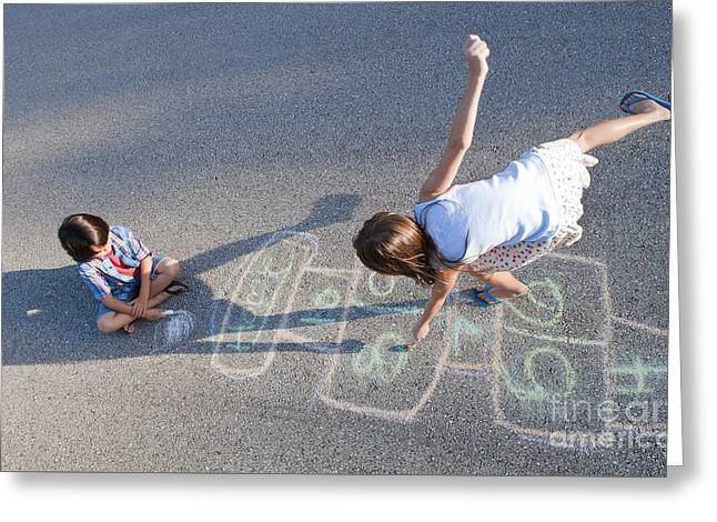 Young Girl Playing Hopscotch On Pavement Greeting Card by Bill Bachmann