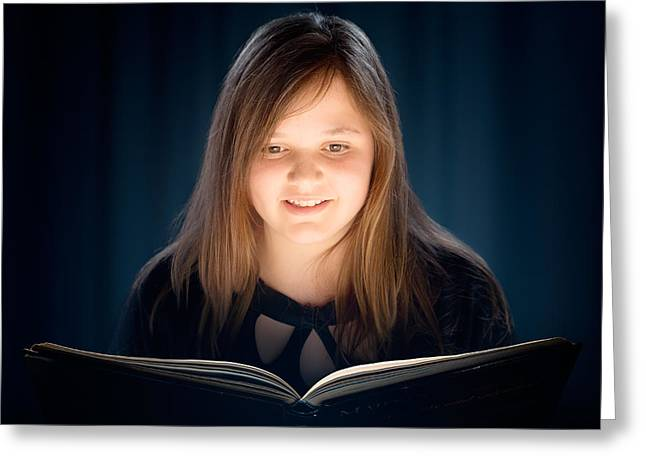 Young Girl Reading A Book Greeting Card by Johan Swanepoel