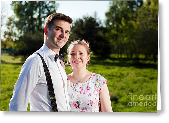 Suspenders Greeting Cards - Young happy couple in love portrait in summer park Greeting Card by Michal Bednarek