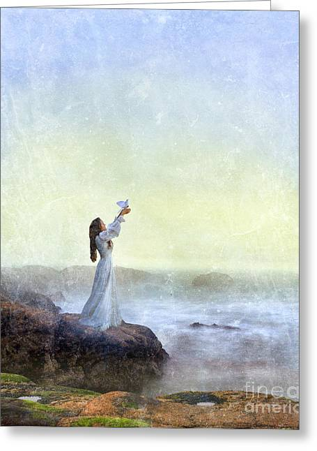 Foggy. Mist Greeting Cards - Young Lady Releasing a Dove by the Sea Greeting Card by Jill Battaglia