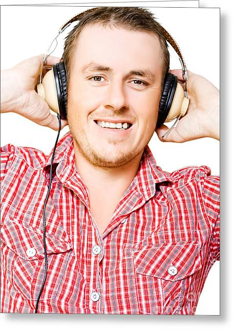 Youthful Greeting Cards - Young man listening to music through earphones Greeting Card by Ryan Jorgensen