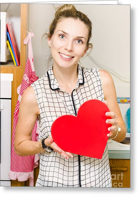 Young Woman In Mid 20s Holding Red Love Heart Greeting Card by Jorgo Photography - Wall Art Gallery