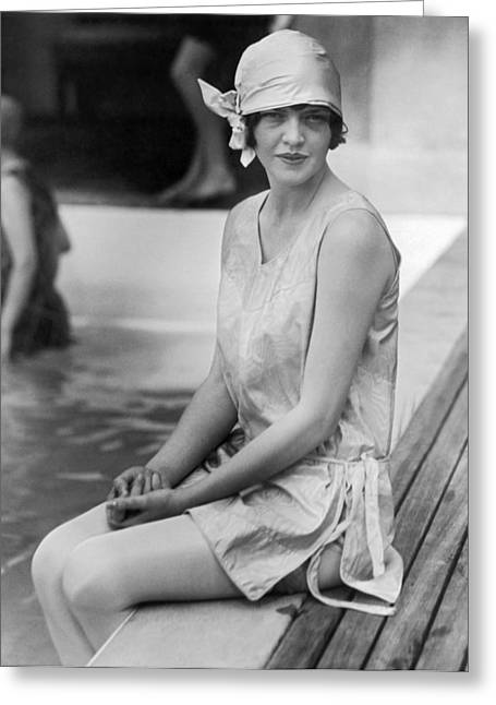 Young Woman Sitting By Pool Greeting Card by Underwood Archives