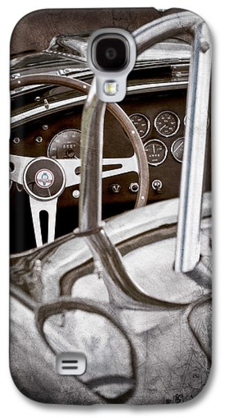 Transportation Photographs Galaxy S4 Cases - 1966 Shelby 427 Cobra Steering Wheel Emblem Galaxy S4 Case by Jill Reger