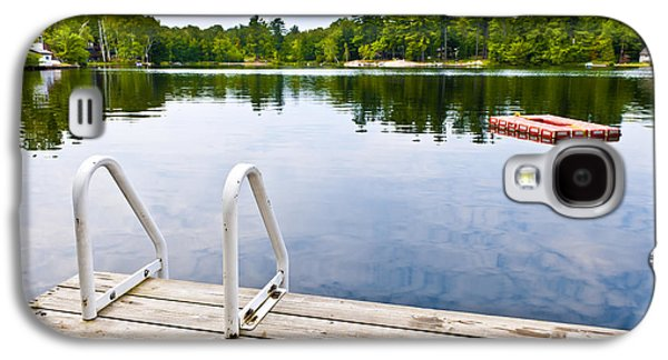 Country Cottage Galaxy S4 Cases - Dock on calm lake in cottage country Galaxy S4 Case by Elena Elisseeva