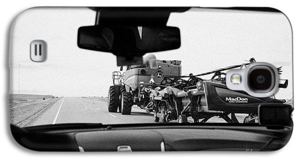 Sask Galaxy S4 Cases - driving behind combine harvester on road in Saskatchewan Canada Galaxy S4 Case by Joe Fox