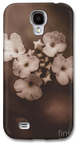 Concept Photographs Galaxy S4 Cases - Finger uplifting a delicate flower blossom Galaxy S4 Case by Ryan Jorgensen