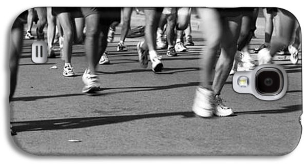 Sports Photographs Galaxy S4 Cases - Low Section View Of People Running Galaxy S4 Case by Panoramic Images