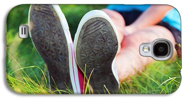 Sneaker Galaxy S4 Cases - Pink sneakers on girl legs on grass Galaxy S4 Case by Michal Bednarek