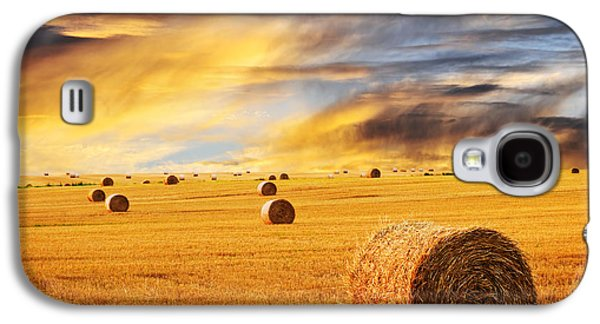 Dramatic Galaxy S4 Cases - Golden sunset over farm field with hay bales Galaxy S4 Case by Elena Elisseeva