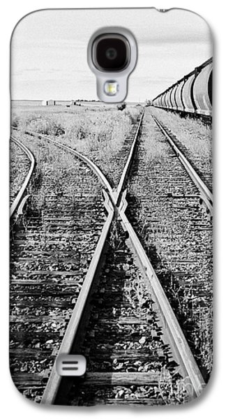 Sask Galaxy S4 Cases - freight grain trucks on former canadian pacific railway now great sandhills railway through leader S Galaxy S4 Case by Joe Fox