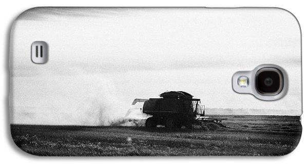 Machinery Galaxy S4 Cases - john deere combine harvesters harvesting on the prairies of Saskatchewan Canada Galaxy S4 Case by Joe Fox