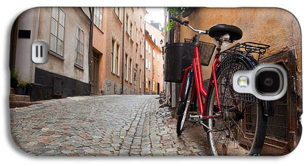 Wall Galaxy S4 Cases - A bike in the old town of stockholm Galaxy S4 Case by Michal Bednarek