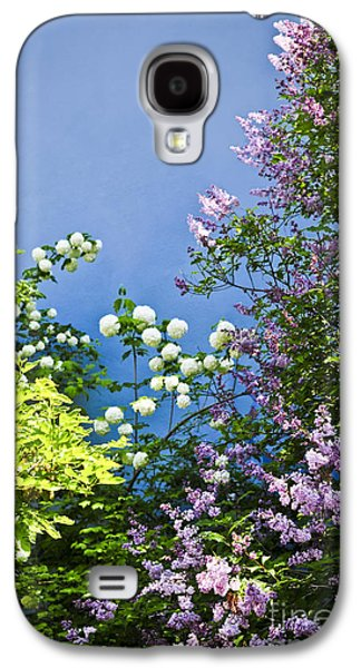 Flower Blooms Galaxy S4 Cases - Blue wall with flowers Galaxy S4 Case by Elena Elisseeva
