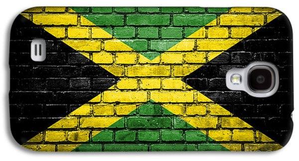 Torn Galaxy S4 Cases - Brick wall with painted flag of Jamaica Galaxy S4 Case by Aleksandar Mijatovic